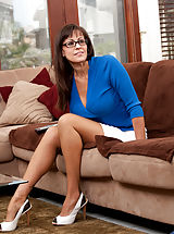 Milf babe in glasses teases her daughters boyfriend with her curves