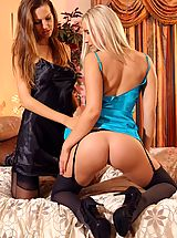 cheap lingerie, Eufrat and Michelle M slowly undress each other and tease each other with their perfect bodies in just stockings and heels.