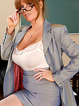 Red High Heels, Busty redhead teacher Darla Crane has hot sex on her desk with one of her students.