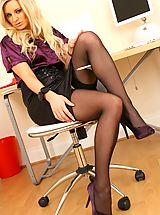High.Heels Pics: Beautiful Meklaina dressed as a secretary wearing a blouse and a skirt but more importantly some sexy lingerie underneath.