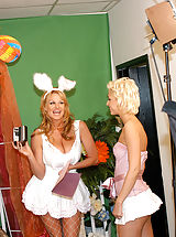 Secretaries, Kelly and Christine take turns hopping up and down on the Easter bunnies cock.