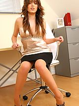 Hot Legs, Brunette Ashley strips from her naughty secretary outfit.