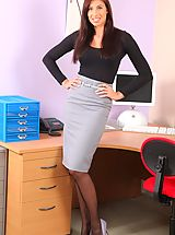 Beautiful secretary posing in the office.