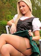 suspender tights, Jana D looks sexy, outside in her skimpy fraulein outfit.