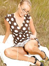 Pantyhose Pics: Sexy secretary Hayley-Marie teases her way out of her brown spotty dress.