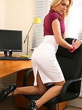 UK Playmates Pics: Blonde looks stunning in her office wearing a tight blouse and a tight long white skirt.